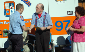 Matthew Millwee, EMT, receives thanks from Monte Moore, and his wife Muriel, for coming to his aid following a choking incident.