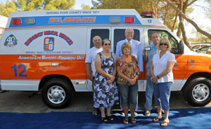 Muroc Healthcare District's Board of Directors presents Harvey L. Hall, Founder & President of Hall Ambulance Service, Inc. with the keys to Paramedic Unit 412.  From left: Dennis Starr, Shelly Kellar Gate, Vieta Searcy, Harvey L. Hall, James Welling, and Karen Callier.