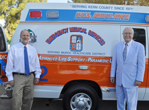 County of Kern EMS Director Ross Elliott takes a tour of the new ambulance with Harvey L. Hall, Founder and President of Hall Ambulance Service, Inc.
