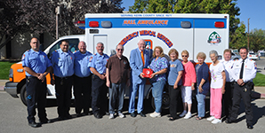 Harvey L. Hall presents an AED to Cari Schnarrenberger, acting VP of the Rosamond Senior Center.