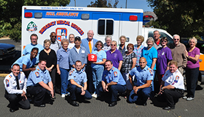 Harvey L. Hall, presents an AED to representatives from the Tehachapi Senior Center, and crews serving from Hall Ambulance's Tehachapi Post.